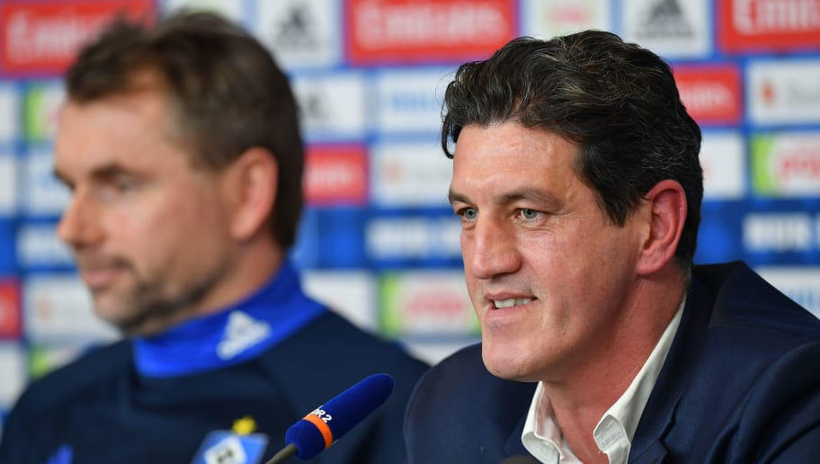 HAMBURG, GERMANY - JANUARY 22:  Jens Todt, sports director of Hamburger SV  talks to the media  as Bernd Hollerbach, new head coach of Hamburger SV looks on during a press conference of Hamburger SV at Volksparkstadion on January 22, 2018 in Hamburg, Germany.  (Photo by Stuart Franklin/Bongarts/Getty Images)