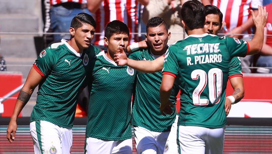 b383fea150c TOLUCA, MEXICO - JANUARY 07: Javier Lopez of Chivas celebrates with  teammates after scoring
