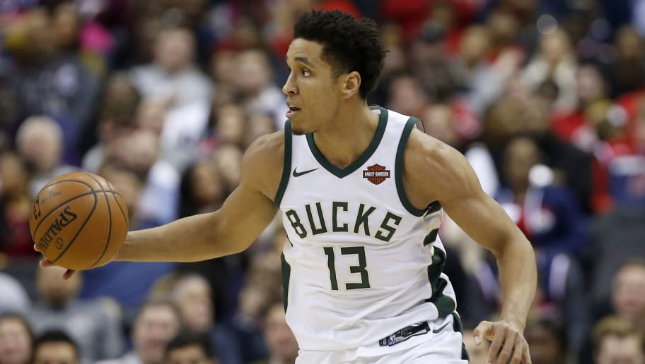 WASHINGTON, DC - JANUARY 6: Malcolm Brogdon #13 of the Milwaukee Bucks dribbles the ball against the Washington Wizards in the first half at Capital One Arena on January 6, 2018 in Washington, DC. NOTE TO USER: User expressly acknowledges and agrees that, by downloading and or using this photograph, User is consenting to the terms and conditions of the Getty Images License Agreement. (Photo by Rob Carr/Getty Images)