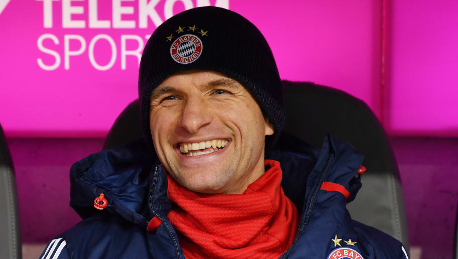 MUNICH, GERMANY - JANUARY 27: Thomas Mueller of Bayern Muenchen smiles on the bench before the Bundesliga match between FC Bayern Muenchen and TSG 1899 Hoffenheim at Allianz Arena on January 27, 2018 in Munich, Germany. (Photo by Sebastian Widmann/Bongarts/Getty Images)