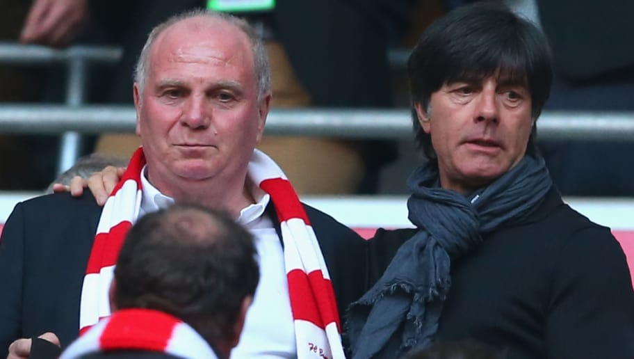 MUNICH, GERMANY - APRIL 12:  Uli Hoeness (L) talks to Joachim Loew, head coach of the German national team prior to the Bundesliga match between FC Bayern Muenchen and BVB Borussia Dortmund at Allianz Arena on April 12, 2014 in Munich, Germany.  (Photo by Alexander Hassenstein/Bongarts/Getty Images)