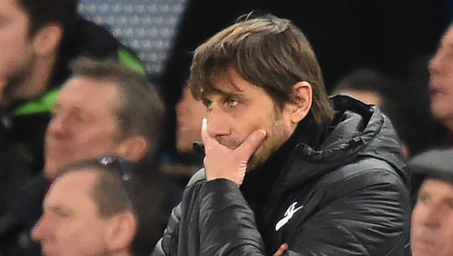 Chelsea's Italian head coach Antonio Conte gestures during the English Premier League football match between Chelsea and Bournemouth at Stamford Bridge in London on January 31, 2018. / AFP PHOTO / Glyn KIRK / RESTRICTED TO EDITORIAL USE. No use with unauthorized audio, video, data, fixture lists, club/league logos or 'live' services. Online in-match use limited to 75 images, no video emulation. No use in betting, games or single club/league/player publications.  /         (Photo credit should read GLYN KIRK/AFP/Getty Images)