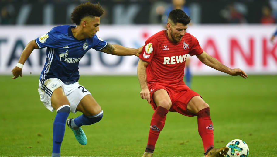 Cologne's Serbian midfielder Milos Jojic (L) and Schalke's German defender Thilo Kehrer vie for the ball during the German football Cup DFB Pokal round of sixteen match FC Schalke 04 vs FC Cologne in Gelsenkirchen, western Germany, on December 19, 2017.  / AFP PHOTO / Patrik STOLLARZ / RESTRICTIONS: ACCORDING TO DFB RULES IMAGE SEQUENCES TO SIMULATE VIDEO IS NOT ALLOWED DURING MATCH TIME. MOBILE (MMS) USE IS NOT ALLOWED DURING AND FOR FURTHER TWO HOURS AFTER THE MATCH. == RESTRICTED TO EDITORIAL USE == FOR MORE INFORMATION CONTACT DFB DIRECTLY AT +49 69 67880   /         (Photo credit should read PATRIK STOLLARZ/AFP/Getty Images)
