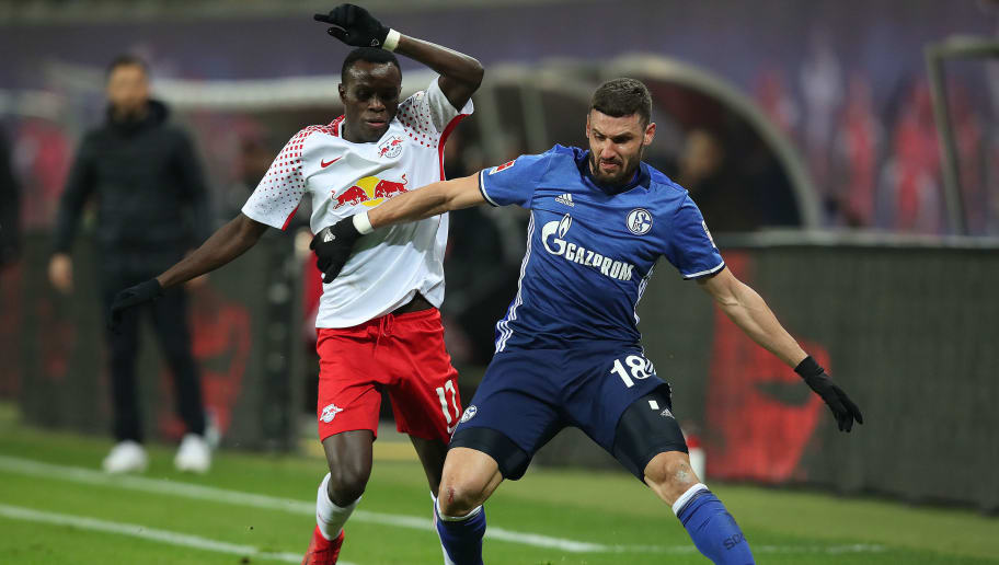 LEIPZIG, GERMANY - JANUARY 13: Bruma of Leipzig (l) fights for the ball with Daniel Caligiuri of Schalke during the Bundesliga match between RB Leipzig and FC Schalke 04 at Red Bull Arena on January 13, 2018 in Leipzig, Germany. (Photo by Ronny Hartmann/Bongarts/Getty Images)