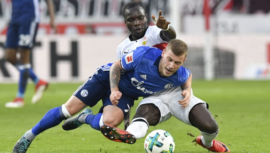 Stuttgart's Congolese forward Chadrac Akolo and Schalke's midfielder Max Meyer (front) vie for the ball during the German first division Bundesliga football match VfB Stuttgart vs Schalke 04 in Stuttgart, southwestern Germany, on January 27, 2018. / AFP PHOTO / THOMAS KIENZLE / RESTRICTIONS: DURING MATCH TIME: DFL RULES TO LIMIT THE ONLINE USAGE TO 15 PICTURES PER MATCH AND FORBID IMAGE SEQUENCES TO SIMULATE VIDEO. == RESTRICTED TO EDITORIAL USE == FOR FURTHER QUERIES PLEASE CONTACT DFL DIRECTLY AT + 49 69 650050         (Photo credit should read THOMAS KIENZLE/AFP/Getty Images)