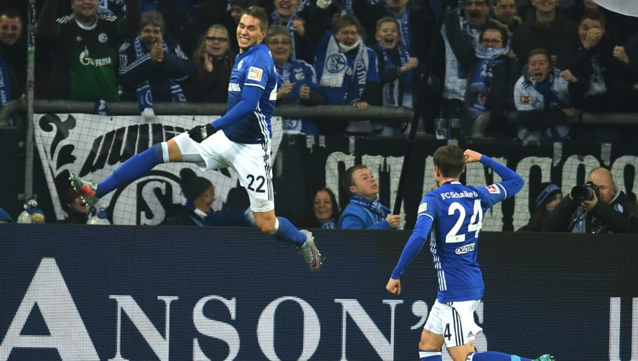 Schalke's midfielder Bastian Oczipka congratulates teammate Marko Pjaca (L) after he scored a goal during the German First division Bundesliga football match FC Schalke 04 vs Hanover 96 in Gelsenkirchen, western Germany, on January 21, 2018. / AFP PHOTO / PATRIK STOLLARZ / RESTRICTIONS: DURING MATCH TIME: DFL RULES TO LIMIT THE ONLINE USAGE TO 15 PICTURES PER MATCH AND FORBID IMAGE SEQUENCES TO SIMULATE VIDEO. == RESTRICTED TO EDITORIAL USE == FOR FURTHER QUERIES PLEASE CONTACT DFL DIRECTLY AT + 49 69 650050         (Photo credit should read PATRIK STOLLARZ/AFP/Getty Images)