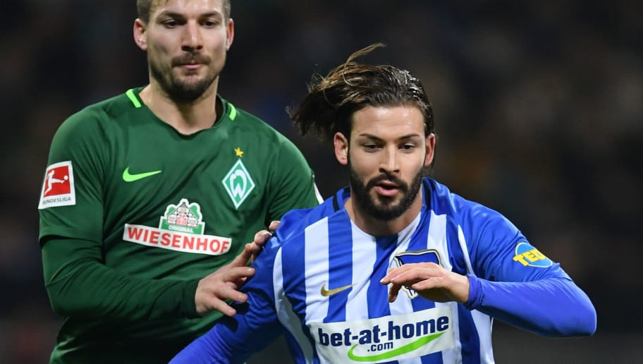 BREMEN, GERMANY - JANUARY 27:  Marvin Plattenhardt of Berlin is chllenged by Jerome Gondorf of Bremen during the Bundesliga match between SV Werder Bremen and Hertha BSC at Weserstadion on January 27, 2018 in Bremen, Germany.  (Photo by Stuart Franklin/Bongarts/Getty Images)