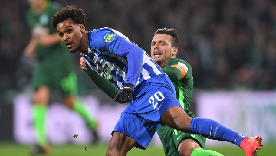 BREMEN, GERMANY - JANUARY 27: Valentino Lazaro of Berlin (l) fights for the ball with Zlatko Junuzovic of Bremen during the Bundesliga match between SV Werder Bremen and Hertha BSC at Weserstadion on January 27, 2018 in Bremen, Germany. (Photo by Stuart Franklin/Bongarts/Getty Images)