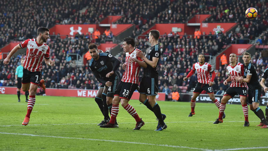 Southampton's Irish striker Shane Long (L) heads the ball to scores his team's first goal during the English Premier League football match between Southampton and West Bromwich Albion at St Mary's Stadium in Southampton, southern England on December 31, 2016. / AFP / Glyn KIRK / RESTRICTED TO EDITORIAL USE. No use with unauthorized audio, video, data, fixture lists, club/league logos or 'live' services. Online in-match use limited to 75 images, no video emulation. No use in betting, games or single club/league/player publications.  /         (Photo credit should read GLYN KIRK/AFP/Getty Images)