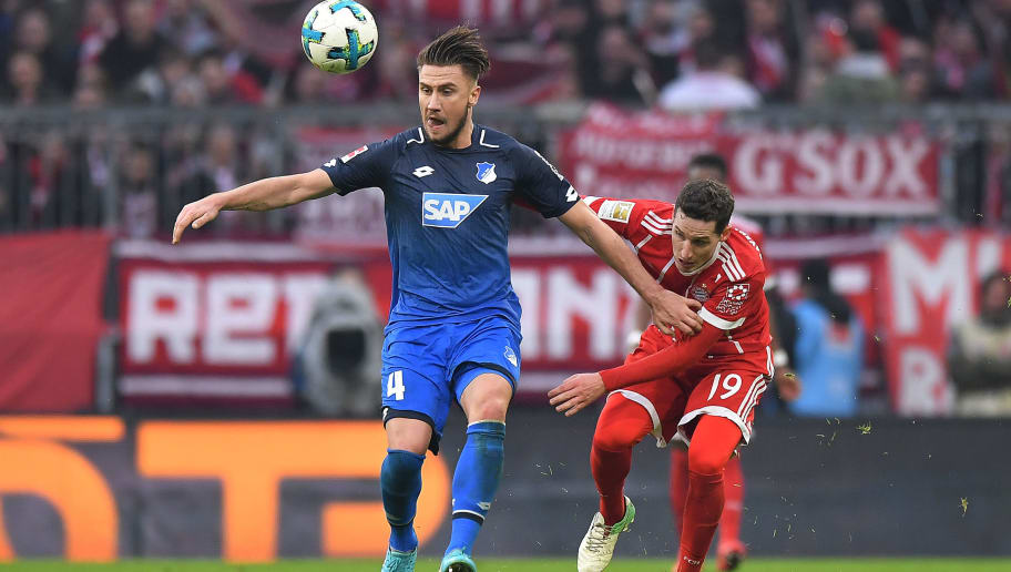 MUNICH, GERMANY - JANUARY 27: Ermin Bicakcic of Hoffenheim (l) fights for the ball with Sebastian Rudy of Bayern Muenchen during the Bundesliga match between FC Bayern Muenchen and TSG 1899 Hoffenheim at Allianz Arena on January 27, 2018 in Munich, Germany. (Photo by Sebastian Widmann/Bongarts/Getty Images)