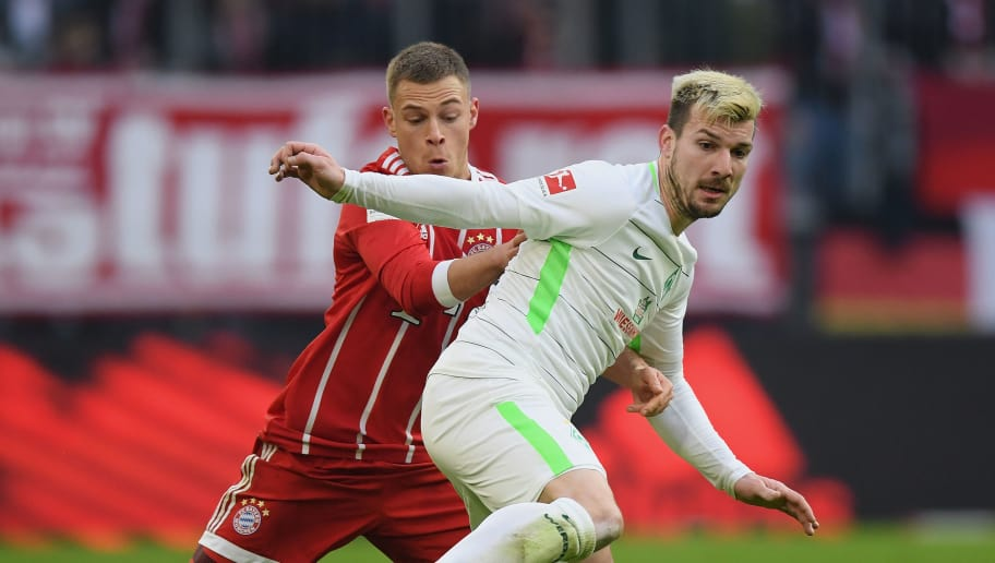 MUNICH, GERMANY - JANUARY 21: Jerome Gondorf of Bremen is challenged by Joshua Kimmich of FC Bayern Muenchen during the Bundesliga match between FC Bayern Muenchen and SV Werder Bremen at Allianz Arena on January 21, 2018 in Munich, Germany. (Photo by Matthias Hangst/Bongarts/Getty Images)