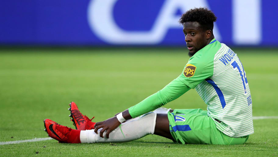 WOLFSBURG, GERMANY - JANUARY 20: Divock Origi of Wolfsburg sits on the pitch during the Bundesliga match between VfL Wolfsburg and Eintracht Frankfurt at Volkswagen Arena on January 20, 2018 in Wolfsburg, Germany. (Photo by Ronny Hartmann/Bongarts/Getty Images)
