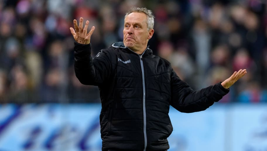 FREIBURG IM BREISGAU, GERMANY - DECEMBER 12: Head coach Christian Streich of Freiburg reacts during the Bundesliga match between Sport-Club Freiburg and Borussia Moenchengladbach at Schwarzwald-Stadion on December 12, 2017 in Freiburg im Breisgau, Germany. (Photo by Alexander Scheuber/Bongarts/Getty Images)