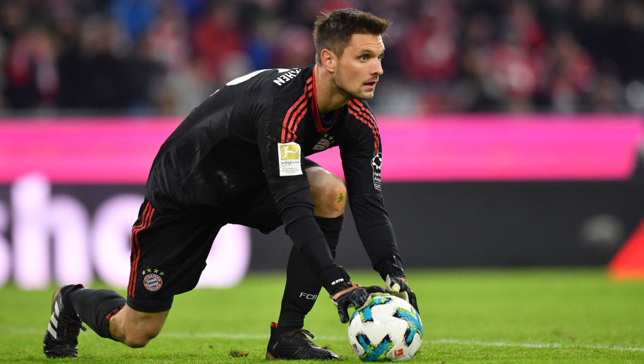 MUNICH, GERMANY - JANUARY 21: Goalkeeper Sven Ulreich of Bayern Muenchen holds the ball during the Bundesliga match between FC Bayern Muenchen and SV Werder Bremen at Allianz Arena on January 21, 2018 in Munich, Germany. (Photo by Sebastian Widmann/Bongarts/Getty Images)