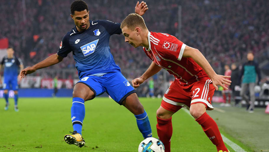 MUNICH, GERMANY - JANUARY 27: Serge Gnabry of Hoffenheim (l) fights for the ball with Joshua Kimmich of Bayern Muenchen during the Bundesliga match between FC Bayern Muenchen and TSG 1899 Hoffenheim at Allianz Arena on January 27, 2018 in Munich, Germany. (Photo by Sebastian Widmann/Bongarts/Getty Images)