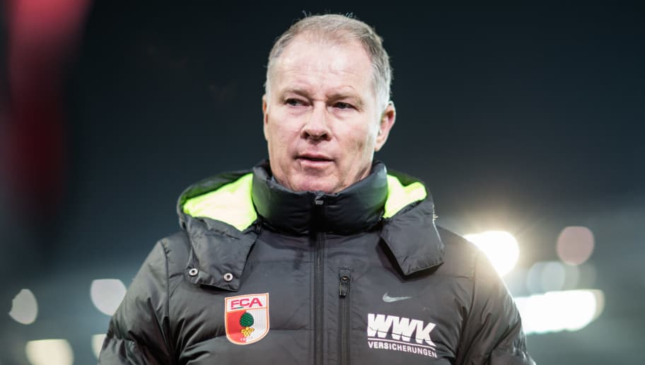 MAINZ, GERMANY - FEBRUARY 10:  Manager Stefan Reuter of Augsburg looks on prior to the Bundesliga match between 1. FSV Mainz 05 and FC Augsburg at Opel Arena on February 10, 2017 in Mainz, Germany.  (Photo by Simon Hofmann/Bongarts/Getty Images)