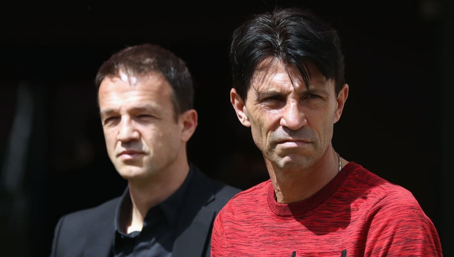 MAINZ, GERMANY - MAY 13:  Manager Bruno Huebner and CEO Fredi Bobic of Frankfurt look on prior to the Bundesliga match between 1. FSV Mainz 05 and Eintracht Frankfurt at Opel Arena on May 13, 2017 in Mainz, Germany.  (Photo by Alex Grimm/Bongarts/Getty Images)