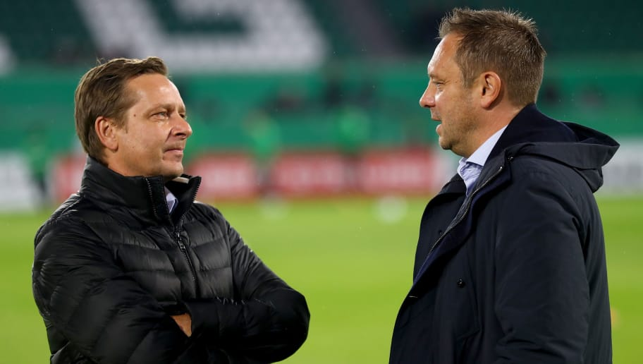 WOLFSBURG, GERMANY - OCTOBER 25:  Andre Breitenreiter (R), head coach of Hannover talks to Horst Heldt, sport director of Hannover before the DFB Cup match between VfL Wolfsburg and Hannover 96 at Volkswagen Arena on October 25, 2017 in Wolfsburg, Germany.  (Photo by Martin Rose/Bongarts/Getty Images)