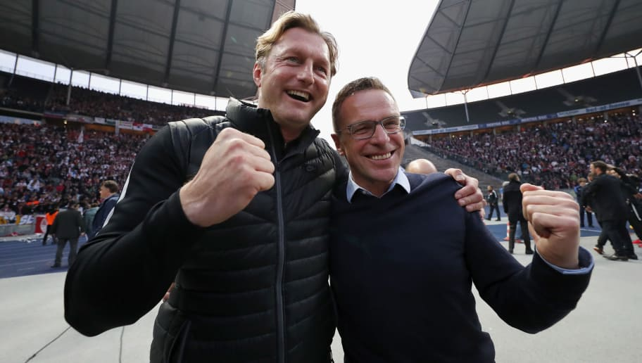BERLIN, GERMANY - MAY 06:  Head coach Ralph Hasenhuettl and Ralf Rangnick of RB Leipzig celebrate the participation of the UEFA Champions League in the next season after winning the Bundesliga match between Hertha BSC and RB Leipzig at Olympiastadion on May 6, 2017 in Berlin, Germany.  (Photo by Boris Streubel/Bongarts/Getty Images)