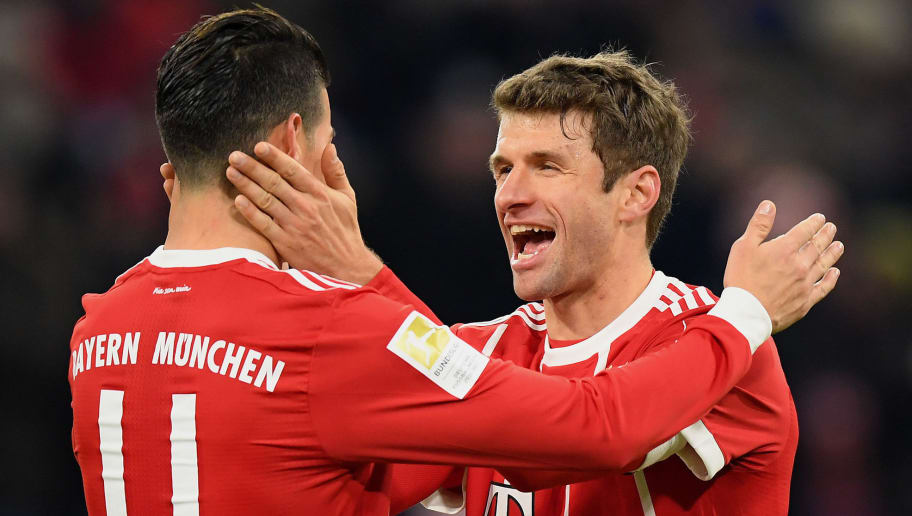 MUNICH, GERMANY - JANUARY 21: Thomas Mueller of FC Bayern Muenchen celebrates with his team-mates after scoring his team's fourth goal during the Bundesliga match between FC Bayern Muenchen and SV Werder Bremen at Allianz Arena on January 21, 2018 in Munich, Germany. (Photo by Matthias Hangst/Bongarts/Getty Images)