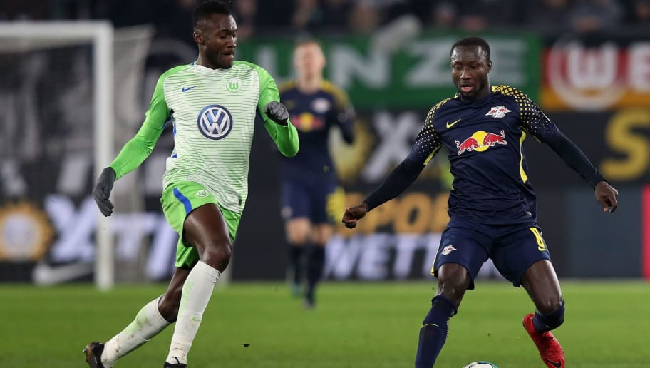 Leipzig's Guinean midfielder Naby Keita (R) and Wolfsburg's French defender Josuha Guilavogui (L) vie for the ball during the German first division Bundesliga football match between VfL Wolfsburg and RB Leipzig on December 12, 2017 in Wolfsburg.  / AFP PHOTO / Ronny Hartmann / RESTRICTIONS: DURING MATCH TIME: DFL RULES TO LIMIT THE ONLINE USAGE TO 15 PICTURES PER MATCH AND FORBID IMAGE SEQUENCES TO SIMULATE VIDEO. == RESTRICTED TO EDITORIAL USE == FOR FURTHER QUERIES PLEASE CONTACT DFL DIRECTLY AT + 49 69 650050         (Photo credit should read RONNY HARTMANN/AFP/Getty Images)
