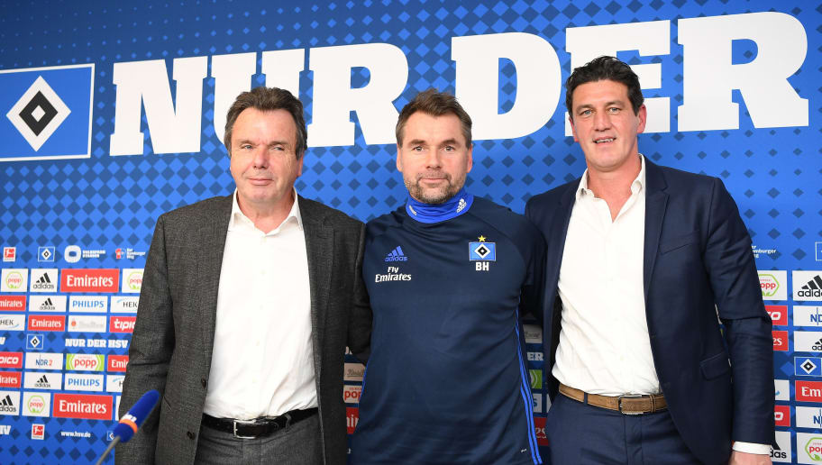 HAMBURG, GERMANY - JANUARY 22:  Heribert Bruchhagen, manager of Hamburg, Bernd Hollerbach, new head coach of Hamburger SV and Jens Todt, sports director of Hamburg pose for a picture during a press conference of Hamburger SV at Volksparkstadion on January 22, 2018 in Hamburg, Germany.  (Photo by Stuart Franklin/Bongarts/Getty Images)