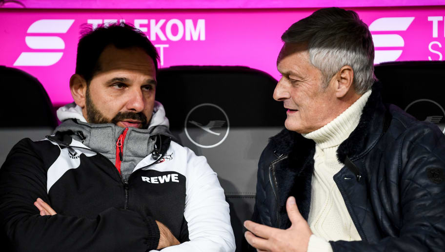 MUNICH, GERMANY - DECEMBER 13: Stefan Ruthenbeck Head Coach of 1. FC Koeln (L) and Sport Director Armin Veh talk prior the Bundesliga match between FC Bayern Muenchen and 1. FC Koeln at Allianz Arena on December 13, 2017 in Munich, Germany.  (Photo by Matthias Hangst/Bongarts/Getty Images)