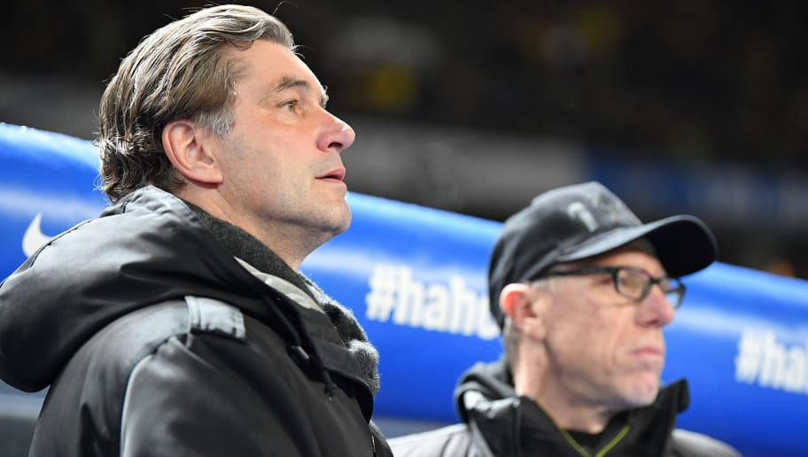 BERLIN, GERMANY - JANUARY 19:  Michael Zorc, sports director of Dortmund looks on with Peter Stoeger, head coach of Dortmund during the Bundesliga match between Hertha BSC and Borussia Dortmund at Olympiastadion on January 19, 2018 in Berlin, Germany.  (Photo by Stuart Franklin/Bongarts/Getty Images)
