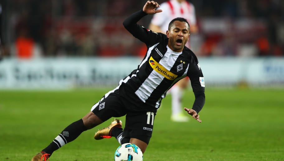 COLOGNE, GERMANY - JANUARY 14:  Raffael of Borussia Monchengladbach is fouled during the Bundesliga match between 1. FC Koeln and Borussia Moenchengladbach at RheinEnergieStadion on January 14, 2018 in Cologne, Germany.  (Photo by Dean Mouhtaropoulos/Bongarts/Getty Images)