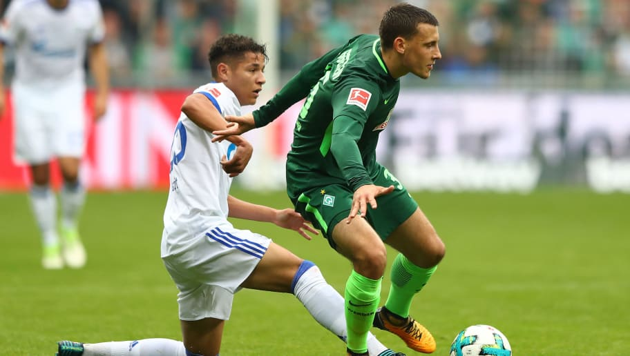 BREMEN, GERMANY - SEPTEMBER 16: Amine Harit of Schalke (l) fights for the ball with Maximilian Eggestein of Bremen during the Bundesliga match between SV Werder Bremen and FC Schalke 04 at Weserstadion on September 16, 2017 in Bremen, Germany. (Photo by Martin Rose/Bongarts/Getty Images)