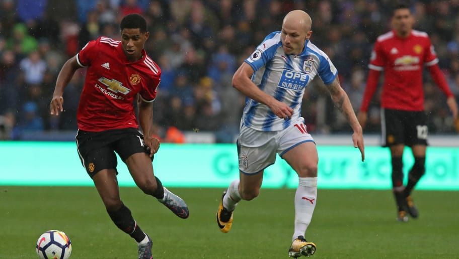Manchester United's English striker Marcus Rashford (L) vies with Huddersfield Town's Australian midfielder Aaron Mooy during the English Premier League football match between Huddersfield Town and Manchester United at the John Smith's stadium in Huddersfield, northern England on October 21, 2017. / AFP PHOTO / Lindsey PARNABY / RESTRICTED TO EDITORIAL USE. No use with unauthorized audio, video, data, fixture lists, club/league logos or 'live' services. Online in-match use limited to 75 images, no video emulation. No use in betting, games or single club/league/player publications.  /         (Photo credit should read LINDSEY PARNABY/AFP/Getty Images)