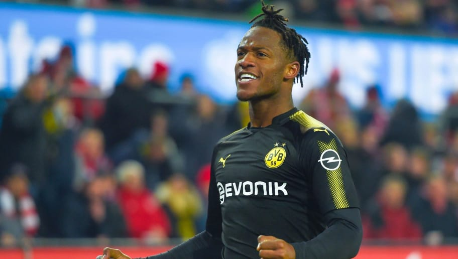 Dortmund's Michy Batshuayi celebrates after scoring a goal during the German first division Bundesliga football match FC Cologne vs Borussia Dortmund in Cologne, western Germany, on February 2, 2018. / AFP PHOTO / Patrik STOLLARZ / RESTRICTIONS: DURING MATCH TIME: DFL RULES TO LIMIT THE ONLINE USAGE TO 15 PICTURES PER MATCH AND FORBID IMAGE SEQUENCES TO SIMULATE VIDEO. == RESTRICTED TO EDITORIAL USE == FOR FURTHER QUERIES PLEASE CONTACT DFL DIRECTLY AT + 49 69 650050         (Photo credit should read PATRIK STOLLARZ/AFP/Getty Images)
