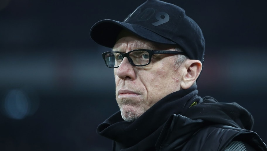COLOGNE, GERMANY - FEBRUARY 02:  Peter Stoeger, head coach of Dortmund looks on during the Bundesliga match between 1. FC Koeln and Borussia Dortmund at RheinEnergieStadion on February 2, 2018 in Cologne, Germany.  (Photo by Alex Grimm/Bongarts/Getty Images)