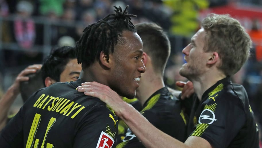 COLOGNE, GERMANY - FEBRUARY 02:  Michy Batshuayi of Dortmund  celebrates scoring his second goal on his debut with teamates during the Bundesliga match between 1. FC Koeln and Borussia Dortmund at RheinEnergieStadion on February 2, 2018 in Cologne, Germany.  (Photo by Alex Grimm/Bongarts/Getty Images)