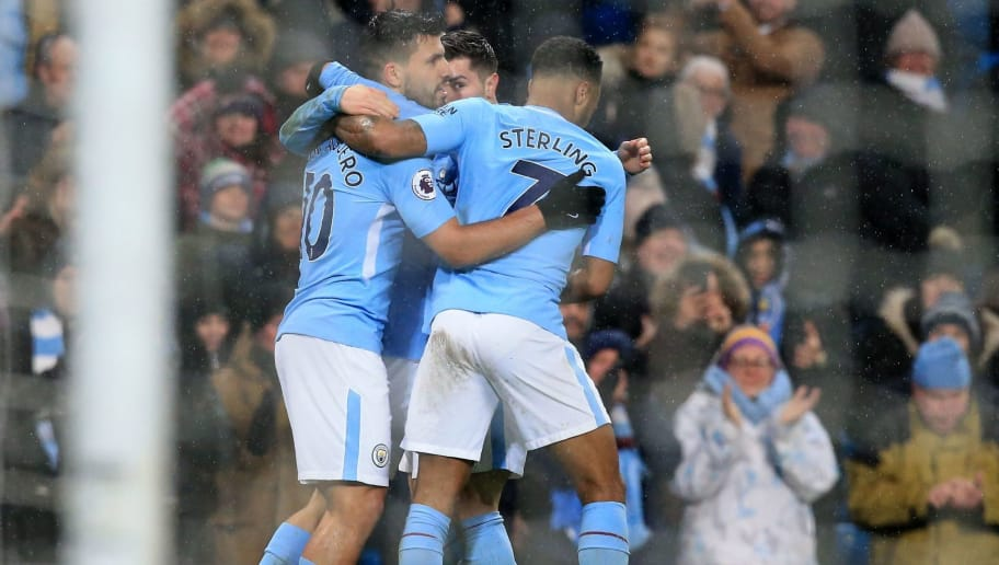 Manchester City's Argentinian striker Sergio Aguero (L) celebrates with teammates after scoring their third goal during the English Premier League football match between Manchester City and West Bromwich Albion at the Etihad Stadium in Manchester, north west England, on January 31, 2018. Manchester City won the game 3-0. / AFP PHOTO / Lindsey PARNABY / RESTRICTED TO EDITORIAL USE. No use with unauthorized audio, video, data, fixture lists, club/league logos or 'live' services. Online in-match use limited to 75 images, no video emulation. No use in betting, games or single club/league/player publications.  /         (Photo credit should read LINDSEY PARNABY/AFP/Getty Images)