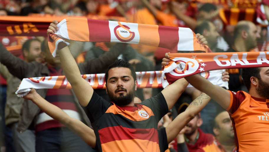 Galatasaray`s fans cheer for their team during the Turkish Spor Toto Super league football match between Galatasaray and Fenerbahce at TT arena stadium on April 13, 2016 in Istanbul. / AFP / OZAN KOSE        (Photo credit should read OZAN KOSE/AFP/Getty Images)