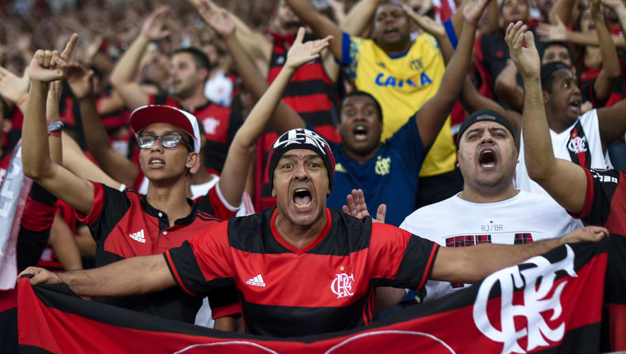 Brazil's Flamengo supporters cheer for their team before the Copa Sudamericana football final against Argentina's Independiente at the Maracana stadium in Rio de Janeiro on December 13, 2017. / AFP PHOTO / MAURO PIMENTEL        (Photo credit should read MAURO PIMENTEL/AFP/Getty Images)