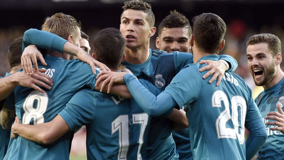 TOPSHOT - Real Madrid's Portuguese forward Cristiano Ronaldo (C) and teammates celebrate Real Madrid's German midfielder Toni Kroos' goal (2L) during the Spanish league football match between Valencia CF and Real Madrid CF at the Mestalla stadium in Valencia on January 27, 2018. / AFP PHOTO / JOSE JORDAN        (Photo credit should read JOSE JORDAN/AFP/Getty Images)