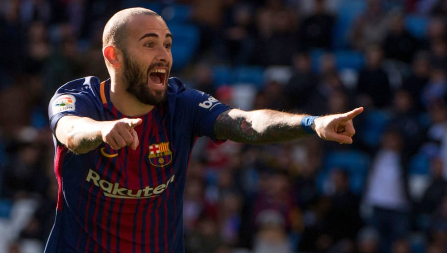 Barcelona's Spanish midfielder Aleix Vidal celebrates after scoring during the Spanish League 'Clasico' football match Real Madrid CF vs FC Barcelona at the Santiago Bernabeu stadium in Madrid on December 23, 2017.  / AFP PHOTO / CURTO DE LA TORRE        (Photo credit should read CURTO DE LA TORRE/AFP/Getty Images)