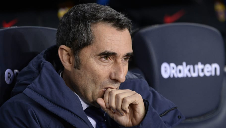 Barcelona's Spanish coach Ernesto Valverde sits on the bench before the Spanish league football match between FC Barcelona and Deportivo Alaves at the Camp Nou stadium in Barcelona on January 28, 2018. / AFP PHOTO / Josep LAGO        (Photo credit should read JOSEP LAGO/AFP/Getty Images)