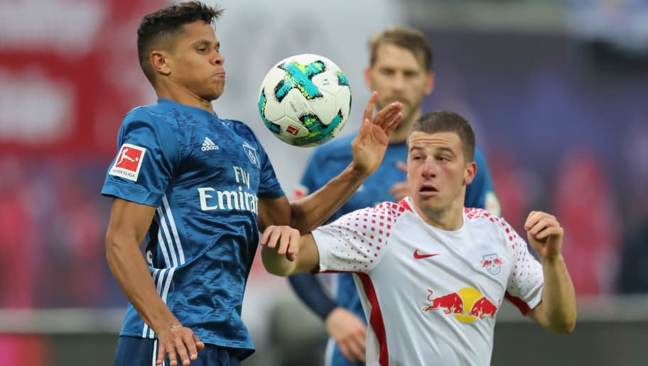 LEIPZIG, GERMANY - JANUARY 27:  Diego Demme of RB Leipzig  battles for the ball with Douglas Santos of Hamburger SV during the Bundesliga match between RB Leipzig and Hamburger SV at Red Bull Arena on January 27, 2018 in Leipzig, Germany.  (Photo by Boris Streubel/Bongarts/Getty Images)