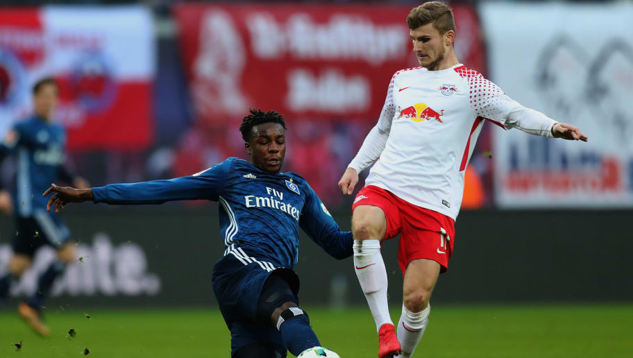 LEIPZIG, GERMANY - JANUARY 27:  Timo Werner of RB Leipzig is challenged by Gideon Jung of Hamburger SV during the Bundesliga match between RB Leipzig and Hamburger SV at Red Bull Arena on January 27, 2018 in Leipzig, Germany.  (Photo by Boris Streubel/Bongarts/Getty Images)
