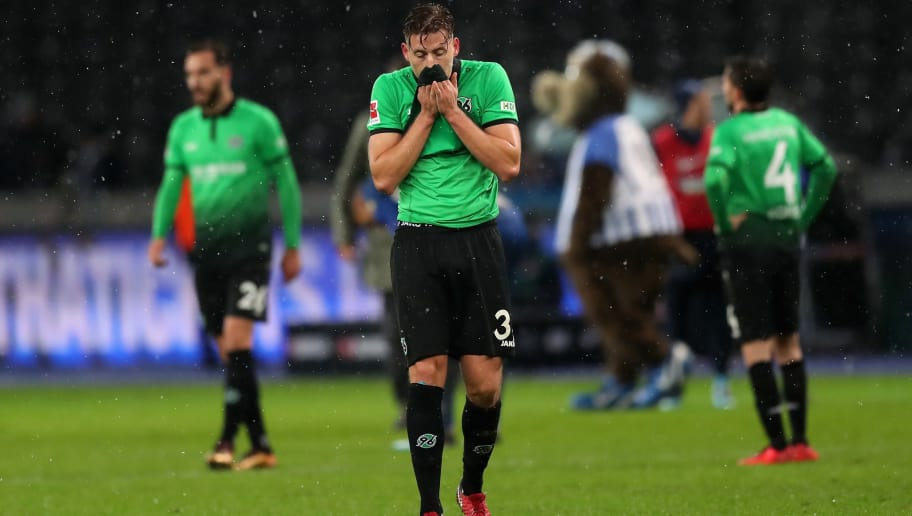 BERLIN, GERMANY - DECEMBER 13:  Waldemar Anton of Hannover 96 reacts after losing the Bundesliga match between Hertha BSC and Hannover 96 at Olympiastadion on December 13, 2017 in Berlin, Germany.  (Photo by Boris Streubel/Bongarts/Getty Images )