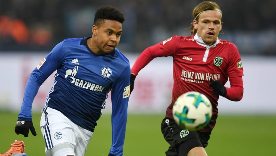 Schalke's midfielder Weston McKennie and Hanover's Norwegian midfielder Iver Fossum vie for the ball during the German First division Bundesliga football match FC Schalke 04 vs Hanover 96 in Gelsenkirchen, western Germany, on January 21, 2018. / AFP PHOTO / PATRIK STOLLARZ / RESTRICTIONS: DURING MATCH TIME: DFL RULES TO LIMIT THE ONLINE USAGE TO 15 PICTURES PER MATCH AND FORBID IMAGE SEQUENCES TO SIMULATE VIDEO. == RESTRICTED TO EDITORIAL USE == FOR FURTHER QUERIES PLEASE CONTACT DFL DIRECTLY AT + 49 69 650050         (Photo credit should read PATRIK STOLLARZ/AFP/Getty Images)