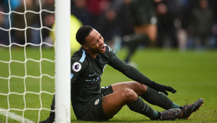 Manchester City's English midfielder Raheem Sterling reacts after missing a chance during the English Premier League football match between Burnley and Manchester City at Turf Moor in Burnley, north west England on February 3, 2018. / AFP PHOTO / Oli SCARFF / RESTRICTED TO EDITORIAL USE. No use with unauthorized audio, video, data, fixture lists, club/league logos or 'live' services. Online in-match use limited to 75 images, no video emulation. No use in betting, games or single club/league/player publications.  /         (Photo credit should read OLI SCARFF/AFP/Getty Images)