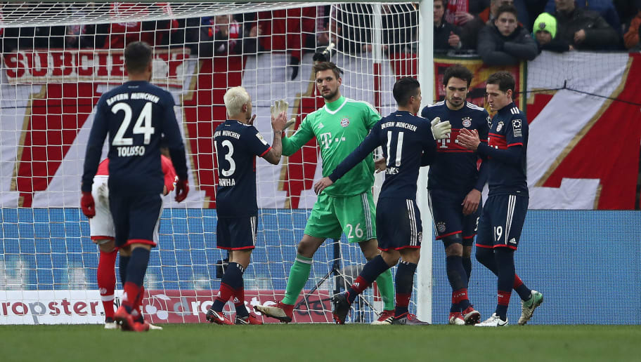MAINZ, GERMANY - FEBRUARY 03: Goalkeeper Sven Ulreich of Bayern Muenchen is celebrated by his team mates after a safe during the Bundesliga match between 1. FSV Mainz 05 and FC Bayern Muenchen at Opel Arena on February 3, 2018 in Mainz, Germany. (Photo by Alex Grimm/Bongarts/Getty Images)