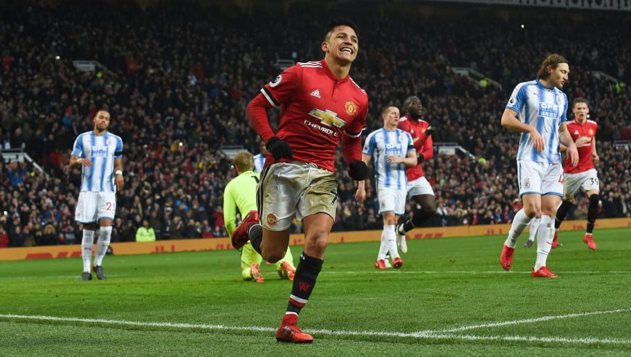Manchester United's Chilean striker Alexis Sanchez celebrates scoring their second goal during the English Premier League football match between Manchester United and Huddersfield Town at Old Trafford in Manchester, north west England, on February 3, 2018. / AFP PHOTO / PAUL ELLIS / RESTRICTED TO EDITORIAL USE. No use with unauthorized audio, video, data, fixture lists, club/league logos or 'live' services. Online in-match use limited to 75 images, no video emulation. No use in betting, games or single club/league/player publications.  /         (Photo credit should read PAUL ELLIS/AFP/Getty Images)