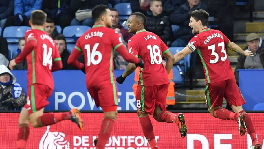 Swansea City's Argentinian defender Federico Fernandez (R) celebrates scoring their first goal to equalise 1-1 during the English Premier League football match between Leicester City and Swansea City at King Power Stadium in Leicester, central England on February 3, 2018. / AFP PHOTO / Ben STANSALL / RESTRICTED TO EDITORIAL USE. No use with unauthorized audio, video, data, fixture lists, club/league logos or 'live' services. Online in-match use limited to 75 images, no video emulation. No use in betting, games or single club/league/player publications.  /         (Photo credit should read BEN STANSALL/AFP/Getty Images)
