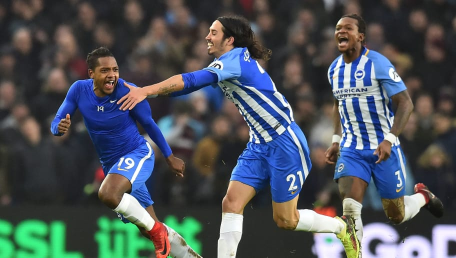 Brighton's Spanish midfielder Jose Izquierdo (L) celebrates with Brighton's Argentine-born Italian defender Ezequiel Schelotto scoring the team's second goal during the English Premier League football match between Brighton and Hove Albion and West Ham United at the American Express Community Stadium in Brighton, southern England on February 3, 2018. / AFP PHOTO / Glyn KIRK / RESTRICTED TO EDITORIAL USE. No use with unauthorized audio, video, data, fixture lists, club/league logos or 'live' services. Online in-match use limited to 75 images, no video emulation. No use in betting, games or single club/league/player publications.  /         (Photo credit should read GLYN KIRK/AFP/Getty Images)