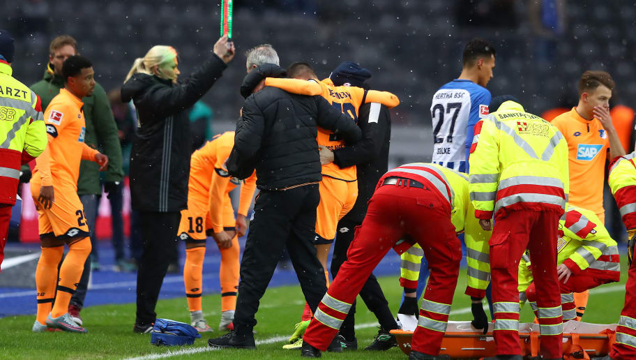 BERLIN, GERMANY - FEBRUARY 03: Kerem Demirbay of Hoffenheim is carried of the pitch injured during the Bundesliga match between Hertha BSC and TSG 1899 Hoffenheim at Olympiastadion on February 3, 2018 in Berlin, Germany. (Photo by Martin Rose/Bongarts/Getty Images)